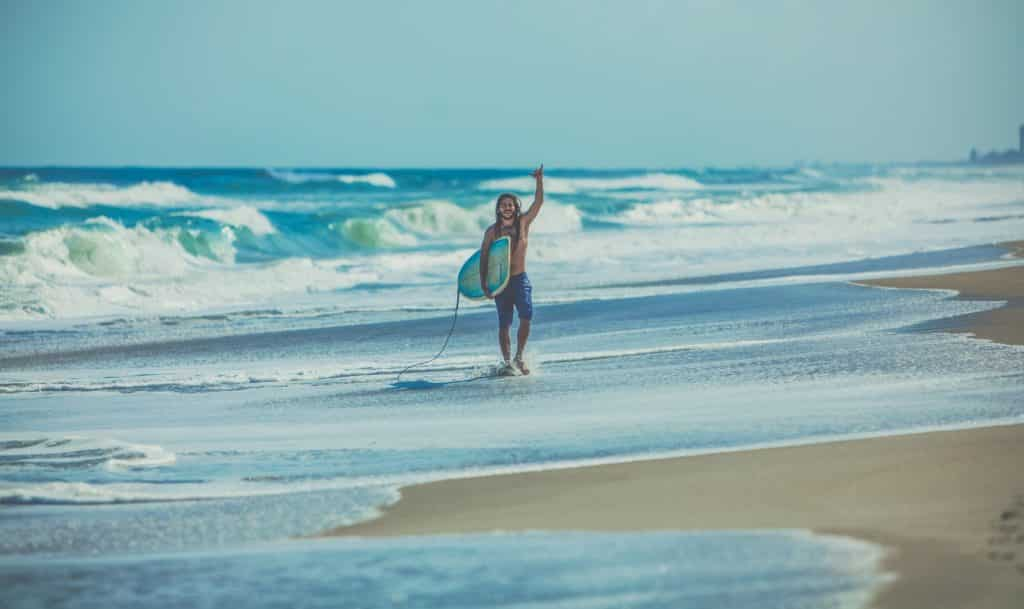 Happy surfer after after learning to surf in Bali