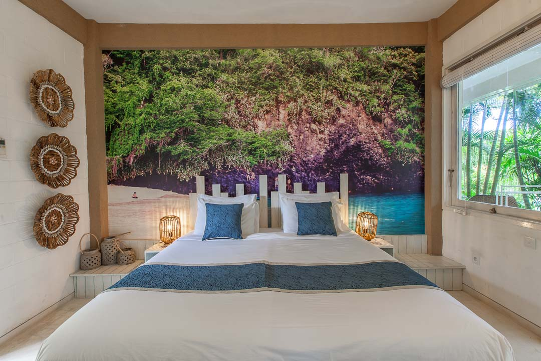 Double bed with a picture of nature on the wall