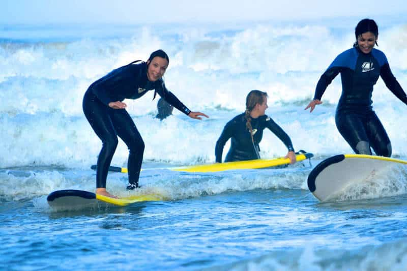 Surfers in wetsuits at Rapture's Ericiera camp