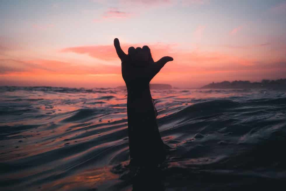 Surfer making a Shaka sign